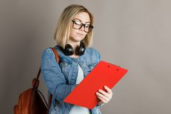 A student with a folder for writing. on a gray background. royalty free stock photo