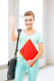 Student with folders and school bag in college Stock Images