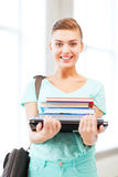 Student with folders and school bag in college Royalty Free Stock Photo