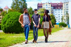 Student friends walking the street Royalty Free Stock Photos