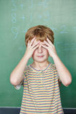Student in front of chalkboard in math class. Elementary school student in front of chalkboard in math class Royalty Free Stock Photos