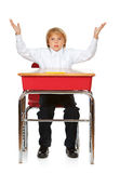 Student: Frustrated Boy At Desk. Isolated on white series of a child in student uniform clothing Stock Photo