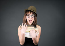 Student in funny glasses with books on grey. Nerd girl studying. Education. Stock Photography