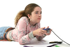 Student Gamer. A student playing video games instead of doing her math homework Royalty Free Stock Photo