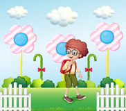 A student in the garden with candies Royalty Free Stock Photography