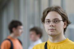 Student in geel overhemd Stock Foto