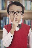 Student gesturing silence Royalty Free Stock Photo