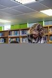 Student getting help from classmate in library Royalty Free Stock Images