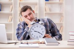 The student getting late with exam preparation Stock Images