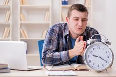 The student getting late with exam preparation. Student getting late with exam preparation Royalty Free Stock Photography
