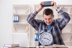 The student getting late with exam preparation Royalty Free Stock Images