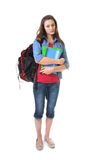 Student girl. Unhappy to go to school holding books and having school bags Royalty Free Stock Photography