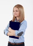 Student girl. Portrait of a young blonde student girl holding a folder Stock Photo
