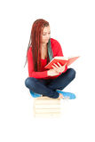 Student girl with african braids reading book Stock Photography