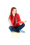 Student girl with african braids reading book Royalty Free Stock Images