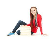Student girl with african braids with the stack of books Stock Photo