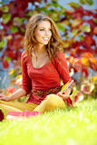 Student girl  against a autumn leaves  background Stock Photo