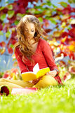 Student girl  against a autumn leaves  background Royalty Free Stock Image