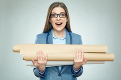 Student girl architect holding blueprints shocked by exams. Royalty Free Stock Photos