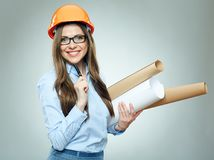 Student girl architect wearing glasses holding rolled up technic Royalty Free Stock Photography