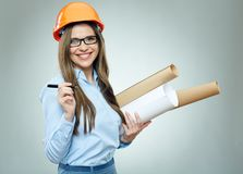 Student girl architect wearing glasses holding rolled up technic Royalty Free Stock Images