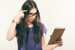 Student girl attentively reading book, free space. Portrait of young woman in glasses carefully studing material in royalty free stock photography