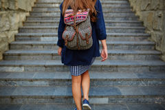 Student girl with a backpack climbing stairs Royalty Free Stock Images