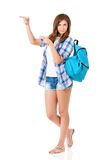 Student girl. Beautiful student girl with backpack pointing up, isolated on white background Stock Images
