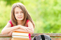 Student girl on bench and smiling Stock Photos