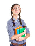 Student girl. In big glasses holding several books and look at camera with superiority feeling on white background Stock Photo