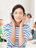 Student girl in big headphones at school Stock Photo