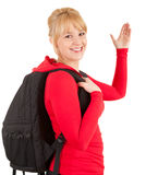 Student girl with black backpack waving hello Stock Image