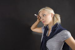 Student girl at blackboard thinking Royalty Free Stock Image