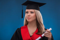 Student girl on blue background Stock Images
