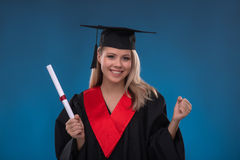 Student girl on blue background Royalty Free Stock Images