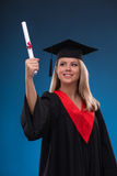Student girl on blue background Royalty Free Stock Image