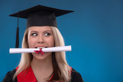 Student girl on blue background Royalty Free Stock Photo