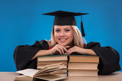 Student girl on blue background Stock Image