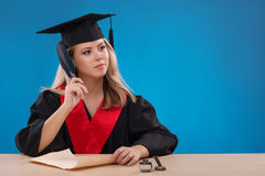 Student girl on blue background Stock Photography