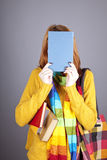 Student girl with blue book near head. Stock Image
