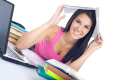 Student girl with book on head Royalty Free Stock Photography
