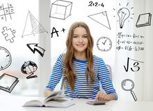 Student girl with book, notebook and calculator Royalty Free Stock Photography