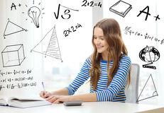 Student girl with book, notebook and calculator Royalty Free Stock Photos
