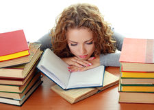 Student girl with books in classroom Stock Images