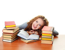 Student girl with books in classroom Royalty Free Stock Images