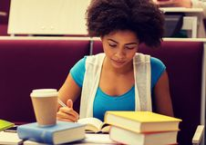 Student girl with books and coffee on lecture royalty free stock image