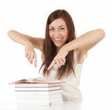 Student girl with books showing something Royalty Free Stock Photography