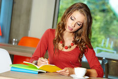 Student girl in cafe Stock Photography