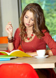 Student girl in cafe Royalty Free Stock Photos