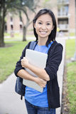 Student girl on campus back to school. Asian student girl on university college campus smiling Stock Image